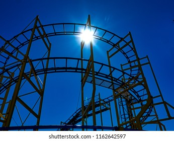 Roller Coaster silhouette against summer sky