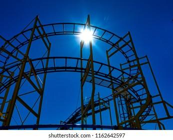 Roller Coaster silhouette against summer sky