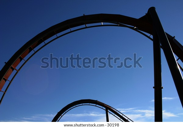 Roller coaster track with blue sky.