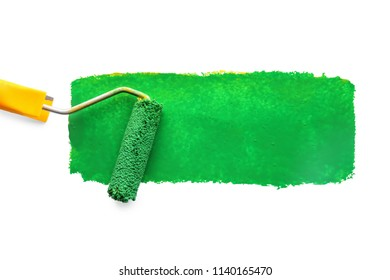 Roller with color paint stroke on white background