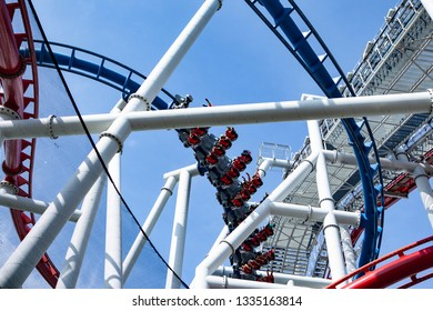 Roller coster ride with blue sky as background