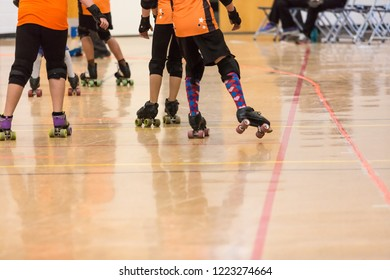 Roller derby players compete against each other