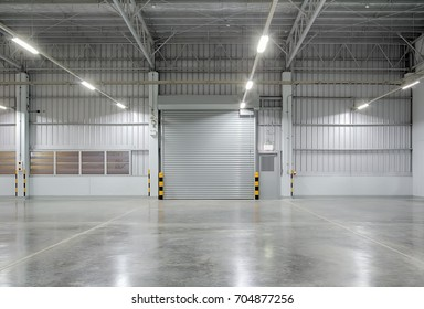 Roller door or roller shutter using for factory, warehouse or hangar. Industrial building interior consist of polished concrete floor and closed door for product display or industry background.
