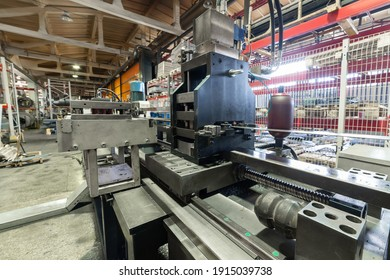 Roller forming machine. The interior of the plant producing a metal profile. Sheet metal processing.
