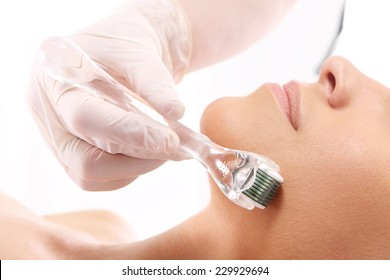 Roller ,microneedle mesotherapy, rejuvenating treatment . Rejuvenation, beautification, the woman at the beautician, Mesotherapy microneedle