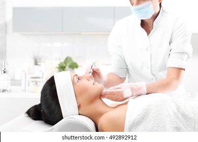 Roller microneedle mesotherapy in the wellness clinic.The woman in the beauty salon for the treatment mezotrrapii with the use of micro needle roller.