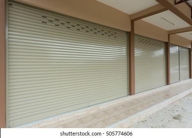 roller shutter door in warehouse building, aluminium steel metal door