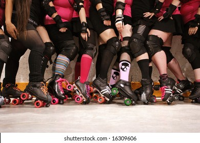 The roller skates and legs of a female Roller Derby team.