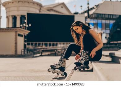 Roller skating sporty girl in park rollerblading on inline skates