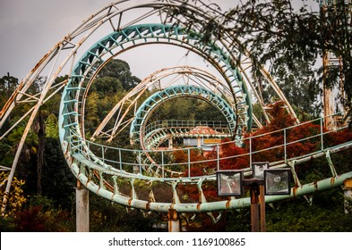 Rollercoaster at abandoned theme park Nara Dreamland with autumn leaves