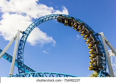 Rollercoaster with people on a blue sky background.