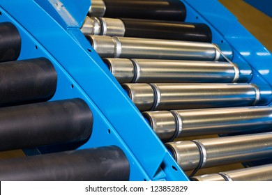 Rollers on a conveyor