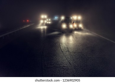 Rolling asphalt at night with headlights. Road construction.