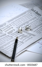 Rolling the dice on the stock market, with analysis sheets and a pen