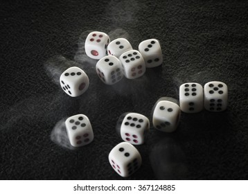 Rolling dices on black background