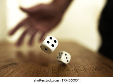 rolling dices on a wooden table