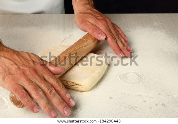 Rolling dough. Making Chocolate Croissants with Puff Pastry