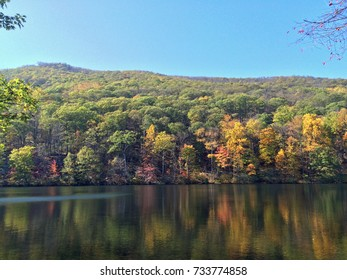 Rolling Hill in Bear Mountain, New York with Beautiful Pastel Leaves Reflecting on the Lake.