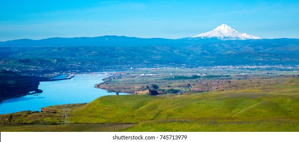 The rolling hills of Columbia Hills State Park, Washington, the Columbia River, City of The Dalles, Oregon and Mt Hood in background.