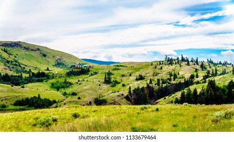 Rolling Hills and wide open Grass Lands of the Nicola Valley in the Shuswap, between Merritt and Kamloops, British Columbia, Canada, under partly cloudy sky