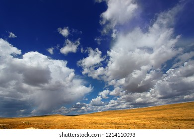 Rolling hills of the Wyoming countryside illuminated under brilliant sunshine