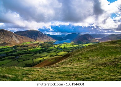 Rolling Lakeland views, rolling hills, mountains and lakes under moody skies in the Cumbrian countryside, the English Lakes