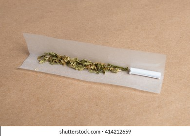 Rolling Paper and processed pot ready to be rolled into a spliff joint to smoke