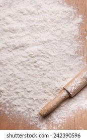 rolling pin and flour on the board