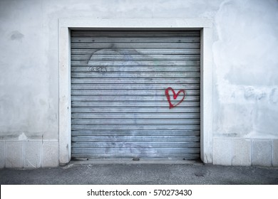 rolling shutter with a red heart, the symbol is painted on the portcullis