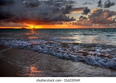 Rolling waves and the sun casting an orange hue on the horizon 1