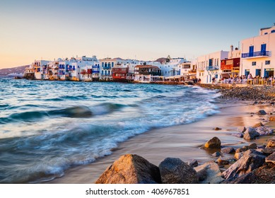 Rolling waves and sunset dining at famous Mykonos neighborhood of Little Venice, Mykonos, Greece