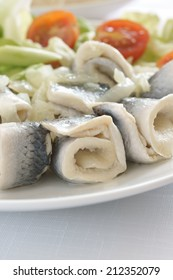 Rollmops or pickled herring fillets served with salad a popular seafood in Northern Europe