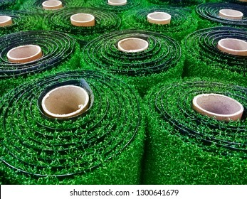 Rolls of artificial grass in a home store