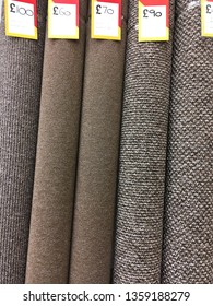 Rolls of carpet on sale at a store