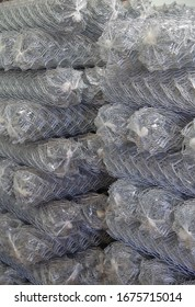 Rolls of chain link fence wire mesh placed them in storage awaiting for sell or disposal wire fence. seamless chain link fence. industrial fence