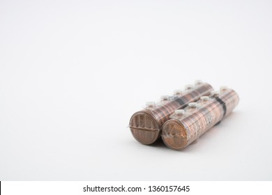 Rolls with coins of five euro cents and one euro cents isolated on white background. Rolls with euros. Savings of coins to enter the bank.