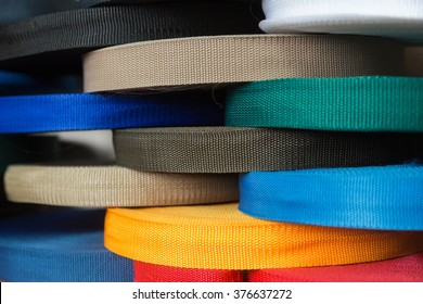 Rolls with color synthetic thread straps. Sewing production furniture