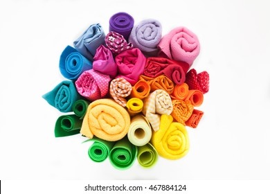 Rolls of colored fabric on a white background. White background. View from above.