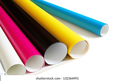Rolls of colored plastic tape placed obliquely.
