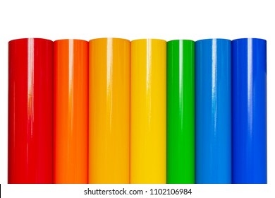 Rolls of colored vinyl film isolated on white background.