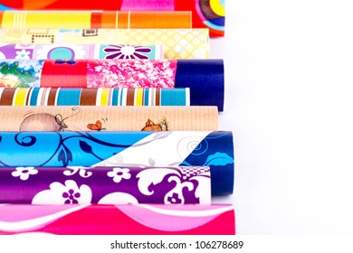 Rolls of colored wrapping paper.