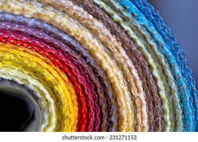 Rolls of colorful fabric available for background texture