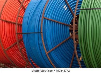 Rolls of colorful plastic pipes or tubes