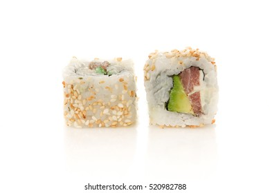 Rolls the delicious sushi on a white background.