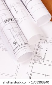 Rolls of diagrams or electrical construction drawings for engineer jobs, technology concept