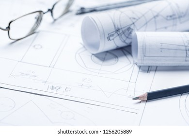 Rolls of drawings with eyepieces in the background. Architectural blueprints and blueprint rolls. selective focus