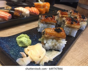 Rolls with eel, soft crab, cream cheese and cucumber served on a plate