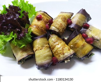 Rolls of eggplant with nut sauce.