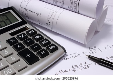 Rolls of electrical diagrams, calculator and mathematical calculations for project, drawings for the projects engineer jobs