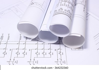 Electrical blueprint imgenes fotos y vectores de stock shutterstock rolls of electrical diagrams on construction drawing drawings for the projects engineer jobs malvernweather Choice Image